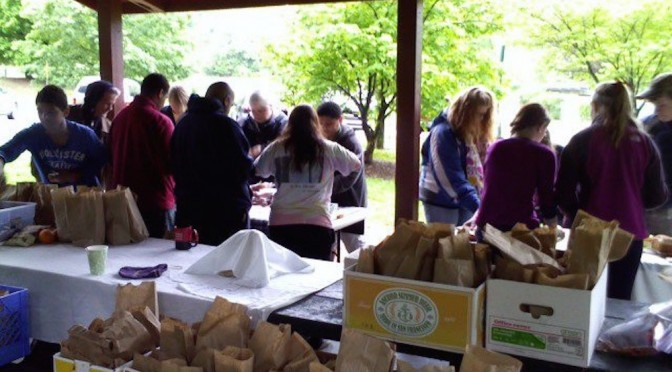 Preparing hygiene kits and lunches in Candler Park for distribution to Atlanta's homeless.